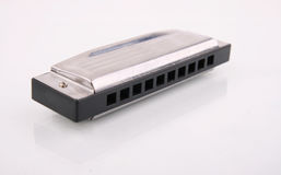 Harmonica. Ordinary harmonica on a white background Royalty Free Stock Images