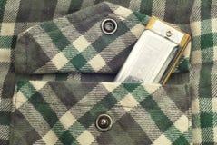 Harmonica dans la poche de chemise de flanelle Images stock