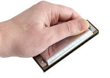 Harmonica in hand Stock Photos