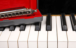 Harmonica and piano Stock Photo