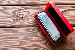 Harmonica in a red bo Royalty Free Stock Photos