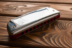 Harmonica on wooden Stock Photos