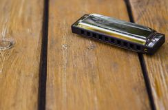 Harmonica on wooden table retro royalty free stock images