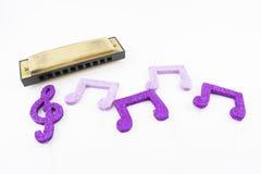 Harmonika met muzikale cijfers royalty-vrije stock afbeelding