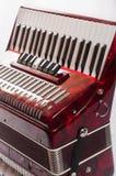 Harmonika van het deel de rode muzikale instrument, witte achtergrond stock afbeeldingen