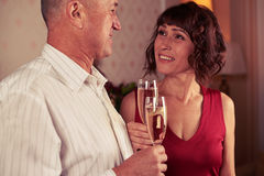 Harmonious couple looking deeply at each other, holding two cham Stock Photos