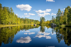 Harmonious picture of a tranquil lake. With reflections of trees and sky Royalty Free Stock Images