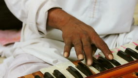 Harmonium playing by a artist stock video