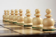 Harmonius team in line. On the chessboard Royalty Free Stock Image