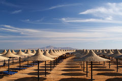 Harmonous numbers of beach umbrellas. Beach in Egypt in the winter Stock Photo