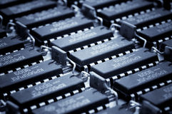 Harmonous numbers of the obsolete microcircuits. Technology background Royalty Free Stock Photos