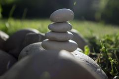 Harmony and balance, cairns, simple poise stones in the garden, rock zen sculpture, white pebbles, single tower. Simplicity royalty free stock photos