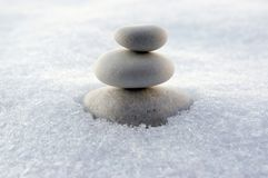 Harmony and balance, cairns, simple poise stones on white background, rock zen sculpture, white pebbles, single tower, simplicity. Harmony and balance, cairns stock image