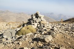Harmony and balance, poise stones against the blue sky in the mountains, rock zen sculpture. Cairn, sunny day, mountains Idi, Crete, Greece, viewpoint, stone stock image