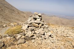 Harmony and balance, poise stones against the blue sky in the mountains, rock zen sculpture. Cairn, sunny day, mountains Idi, Crete, Greece, viewpoint, stone stock photo