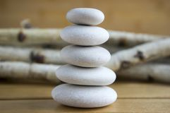 Harmony and balance, simple pebbles tower on wooden background royalty free stock image