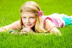 Harmony. Beautiful teenage girl lying on a green lawn in the park. Harmony. Holiday Stock Photos
