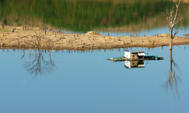 Harmony landscape, floating house ,reflection, dry tree Stock Photography