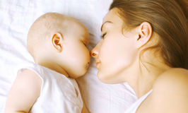 Harmony, love - Baby and mom sleep Stock Photo