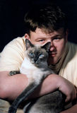 Harmony & Me 4. Teenage boy and Siamese cat royalty free stock photo