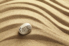 Harmony Pebble on sand Stock Photos