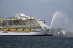 Harmony of the Seas world's largest cruise ship. Harmony of the Seas the worlds' largest cruise ship gets a traditional water spray send off from tug Lomax on Royalty Free Stock Photo