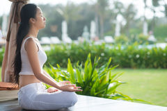 Harmony. Side view of a meditating woman Royalty Free Stock Image
