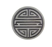 Harmony stone. Asian harmony symbol carved into stone and highlighted with black dye Stock Images