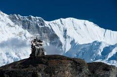 Harmony: Stone stack and mountain range in Himalayas. Gokyo, Nepal Stock Photography