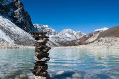Harmony: Stone stack and Sacred Gokyo Lake. Travel to Nepal Stock Images