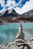 Harmony: Stone stack and Sacred Lake near Gokyo. Travel to Nepal Stock Image