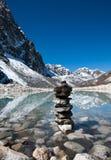 Harmony: Stone stack and Sacred Lake near Gokyo. In Himalayas Royalty Free Stock Photography