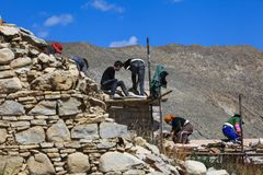 Harmony of Tibetan villagers to build the temple royalty free stock image