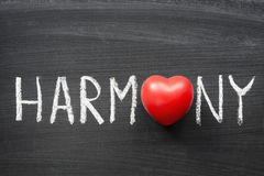 Harmony. Word handwritten on blackboard with heart symbol instead O Royalty Free Stock Photography