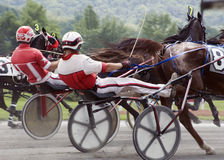 Harness race-2. Closeup of sulky and drivers close race Stock Photography