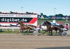 Harness Racing on Karlshorst racetrack Stock Photos