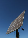 Harness the sun. Large solar panel on pole stock photo