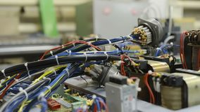 Harnesses of electrical cables lie on the circuit board. Assembling the control system of a modern CNC machine. Harnesses of electrical cables lie on the stock video footage