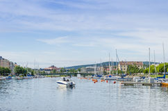 Harnosand inner harbour. (Swedish:  Härnösand) with leisure boats and the North bridge (Swedish: Nybron). Norrland, Sweden Royalty Free Stock Photography