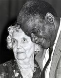 Harold Washington. Chicago`s first African-American mayor, shares a tender moment honoring a senior citizen for her prodigious volunteer work among the elderly Royalty Free Stock Photos
