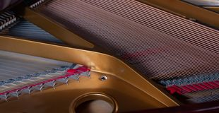 The harp of a grand piano royalty free stock image