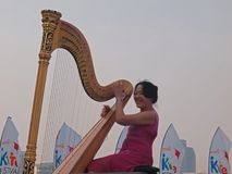 Harp Performance at Marina Bay Royalty Free Stock Photo