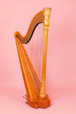 Harp on a pink background Royalty Free Stock Photo