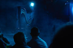 The harp on stage. Blue atmosphere of the harp on stage Royalty Free Stock Photo