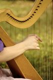 Harp String Harmony. The magical talented hands of the Harpist entertains and delights the mind and spirit Stock Photo