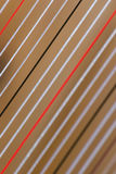 Harp strings. Red, white and black strings of folk harp royalty free illustration