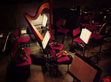 Harp and violins in orchestral pit Stock Photo