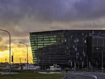 Harpa Concert Hall at sunset. Modern glass building under overcast clouds at sunset royalty free stock photos