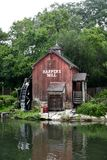 Harper's Cider Mill. This is a Summer picture of the iconic Harper's Cider Mill located on Tom Sawyer Island at Disneyworld in Orlando, Florida.  The mill is an Stock Photography