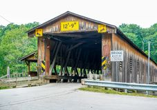 Over One Hundred Years Old. This is Harpersfield Covered Bridge that spans the Grand River in northeast Ohio the bridge is over a hundred years old and cars Stock Photography